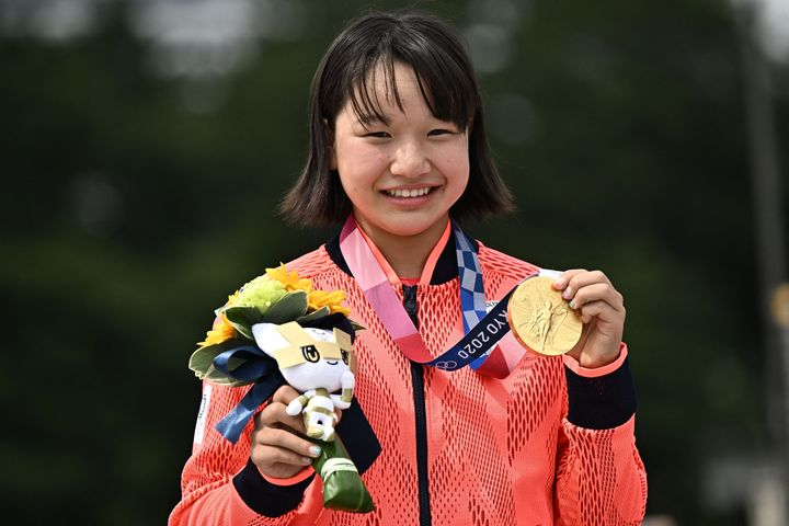 Japan's Momiji Nishiya poses with her gold medal for the skateboarding women's street final of the Tokyo 2020 Olympic Games.