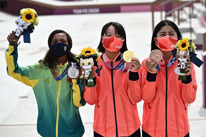 Brazil's Rayssa Leal (silver), Japan's Momiji Nishiya (gold), and Japan's Funa Nakayama (bronze) pose during the medal ceremo
