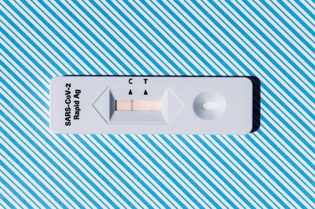 Covid-19 rapid antigen diagnostic test device on a blue