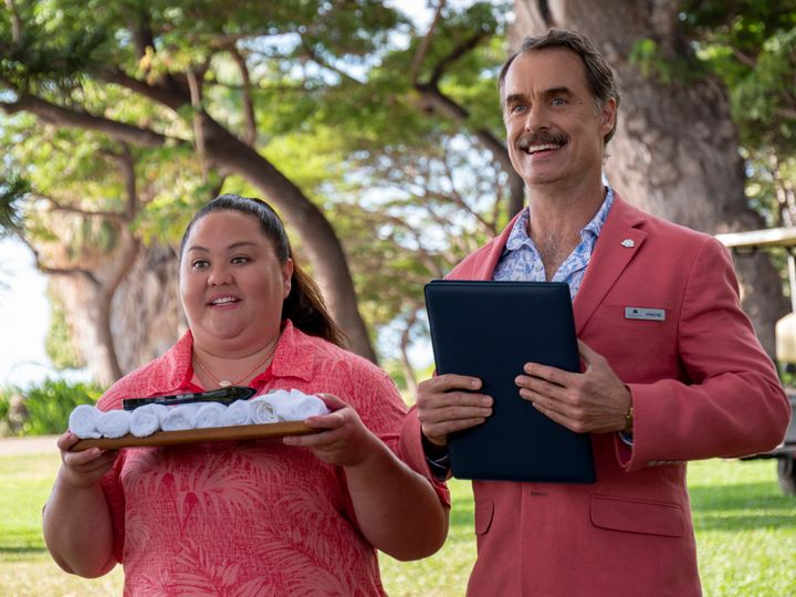 """Lani (Jolene Purdy) and Armond (Murray Bartlett) greet new guests at the White Lotus on HBO's """"The White Lotus."""""""