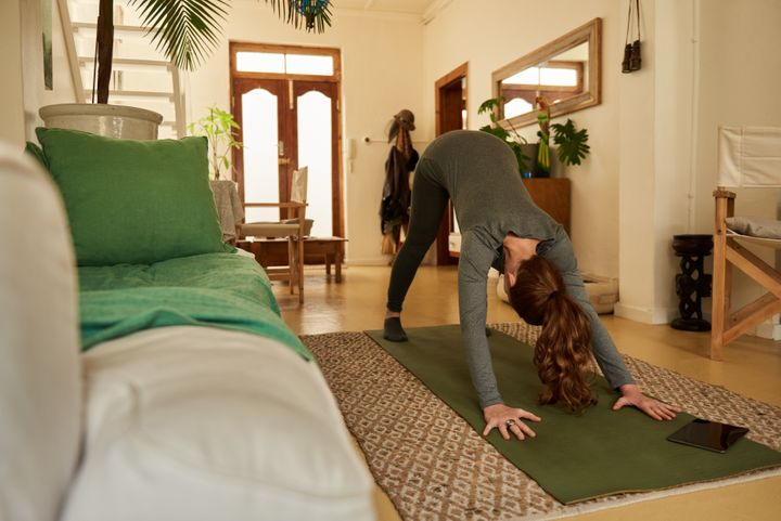 Start your a.m. with a downward dog to get your blood flowing and increase alertness.
