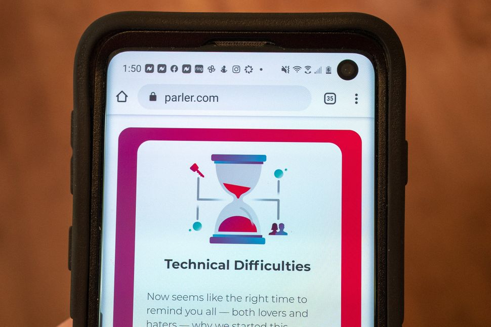 """Mobile device showing the conservative Parler website with a statement about """"Technical Difficulties"""" following the app's rem"""