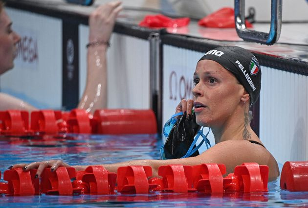 Italy's Federica Pellegrini reacta after a heat for the women's 200m freestyle swimming event during...