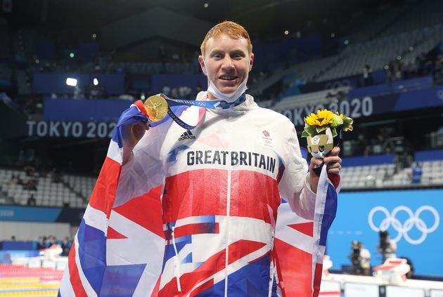 Tom Dean of Great Britain poses with his medal after winning the Men's 200m Freestyle final on day four...