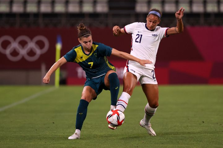 KASHIMA, JAPAN - JULY 27: Steph Catley of Australia battles for possession with Lynn Williams of the United States.