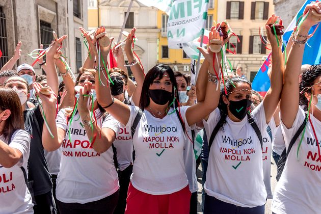 ROME, ITALY - JULY 22: Whirlpool women workers arrive in front of the Ministry of Economic Development to protest against closure of Whirlpool plant in Naples and consequent dismissal of workers on July 22, 2021 in Rome, Italy. The Whirpool workers are protesting against a collective layoff of 340 employees by the American company. (Photo by Stefano Montesi - Corbis/Corbis via Getty Images)
