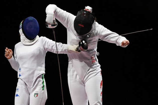 China's Xu Anqi (R) compete against Italy's Rossella Fiamingo in the womens team epee bronze medal bout...