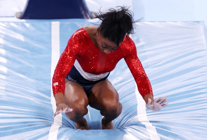 Simone Biles stumbles upon landing after competing in vault during the Women's Team Final on day four of the Tokyo 2020 Olymp