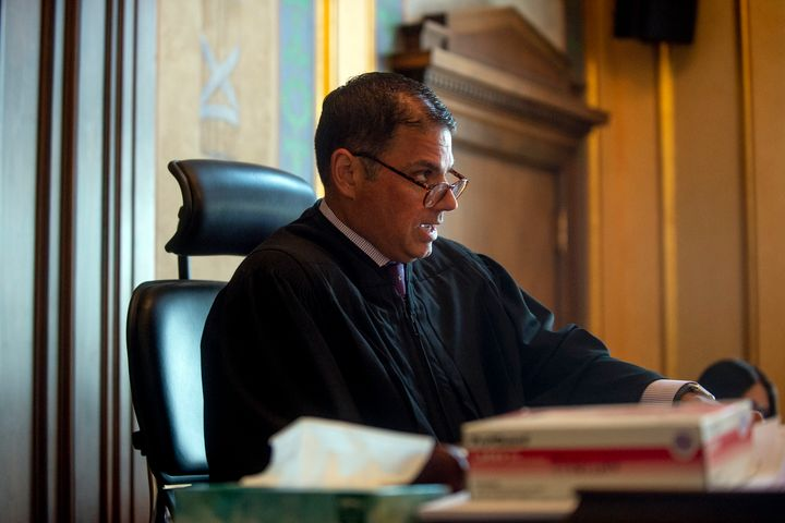 Genesee County Circuit Judge Mark Latchana on Monday ordered the money distributed by Shiawassee County commissioners to be f
