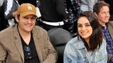 Ashton Kutcher and Mila Kunis at a basketball game in 2019.