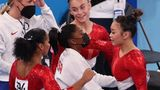 TOKYO, JAPAN - JULY 27: (L-R) Simone Biles, Grace McCallum, and Jordan Chiles hug Sunisa Lee of Team United States as she competes on uneven bars during the Women's Team Final on day four of the Tokyo 2020 Olympic Games at Ariake Gymnastics Centre on July 27, 2021 in Tokyo, Japan. (Photo by Jamie Squire/Getty Images)