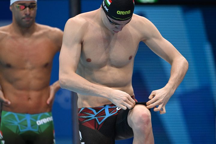 Kristof Milak adjusts his swim trunks ahead of the final of the men's 200-meter butterfly final at the Tokyo Olympics.
