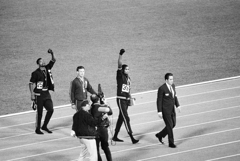 (Original Caption) 1968-Mexico City, Mexico- Tommie Smith, center, and John Carlos, right, of the United...