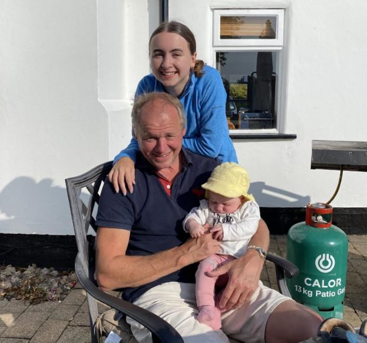 The author with her dad and her baby sister in her dad's garden in September 2020.