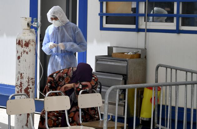 A woman infected by the Covid-19 coronavirus receives oxygen as a first aid at a hospital in the northwestern...