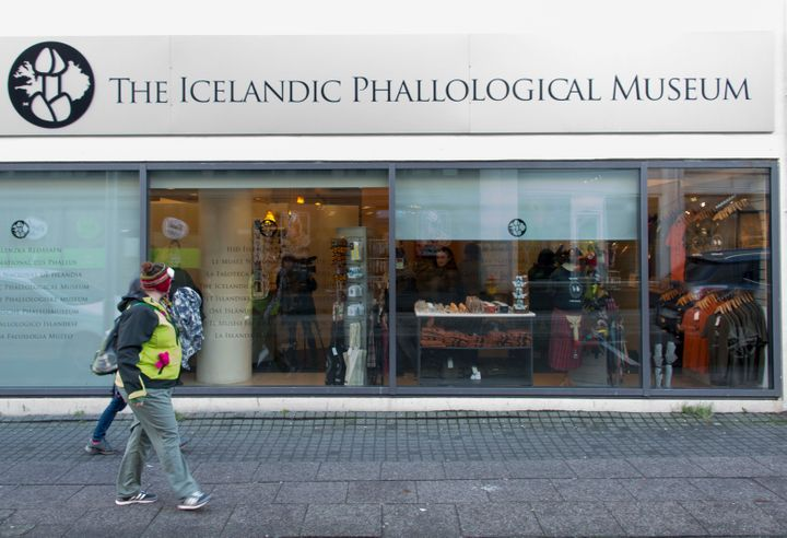 People walk outside the Icelandic Phallological Museum in Reykjavik, Iceland. Inside the museum, there are penises and penile