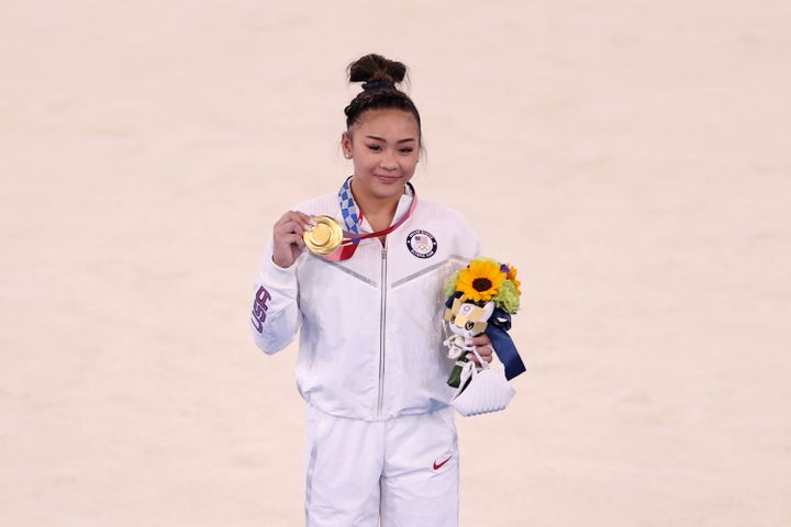 Sunisa Lee of the U.S. poses with her gold medal after winning the women's all-around gymnastics final at the Tokyo Games on