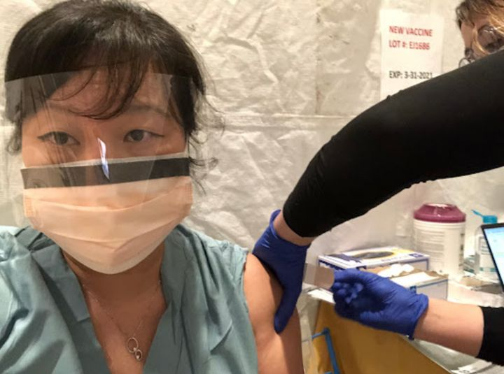 The author receiving her COVID-19 vaccination.