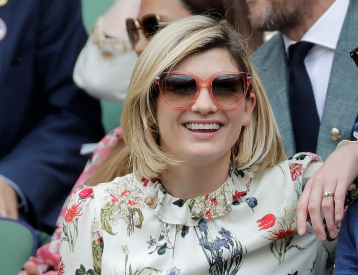 FILE - In this file photo dated Saturday, July 13, 2019, actress Jodie Whittaker sits in the Royal Box on Centre Court to wat