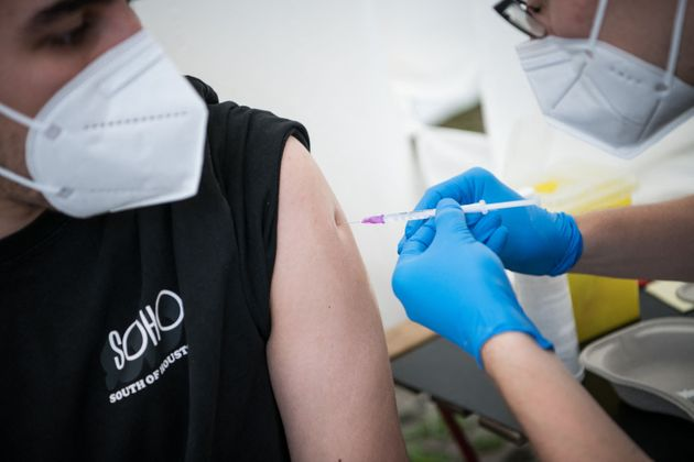A man is vaccinated against the COVID-19 coronavirus at a drive thru vaccination center outside an IKEA...