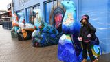 """Aria Luna with """"Deep Blue,"""" her sea lion statue at Pier 39 in San Francisco. January 2020."""