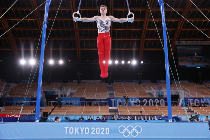 Shane Wiskus of Team USA, who said he doesn't mind the crowdless factor, competes on rings during men's qualification at the 2020 Olympic Games at Ariake Gymnastics Center.