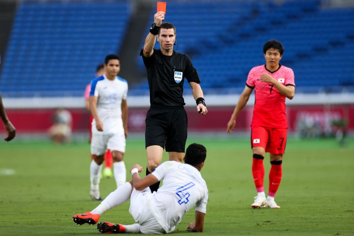 With zero fan pressure, referee Kabakov Georgi gives a red card to Carlos Melendez of Honduras during the men's Group B match at the Tokyo Games on July 28, 2021.