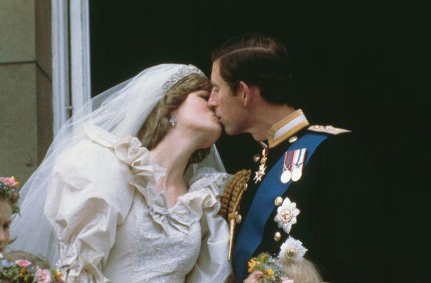 Prince Charles, Prince of Wales, kissing his wife, Princess Diana (1961 - 1997), on the balcony of Buckingham...