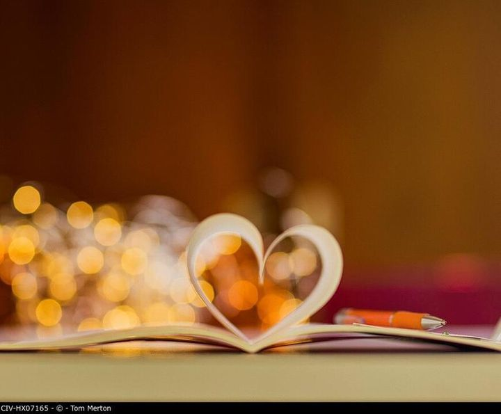 Book pages forming heart shape
