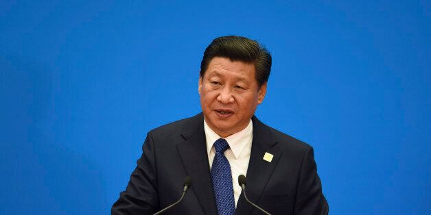 China's President Xi Jinping speaks during a press conference to close the Asia-Pacific Economic Cooperation (APEC) Summit at