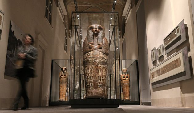 A visitor looks at the sarcophagus of Butehamon at the Museu Egizio (Egyptian Museum) in Turin, the only...