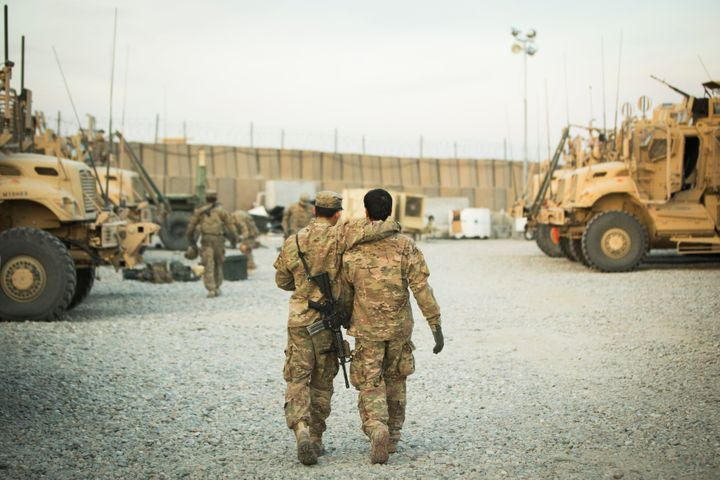 In this2014 file photo, a U.S. soldier from the 3rd Cavalry Regiment walks with the unit's Afghan interpreter before a