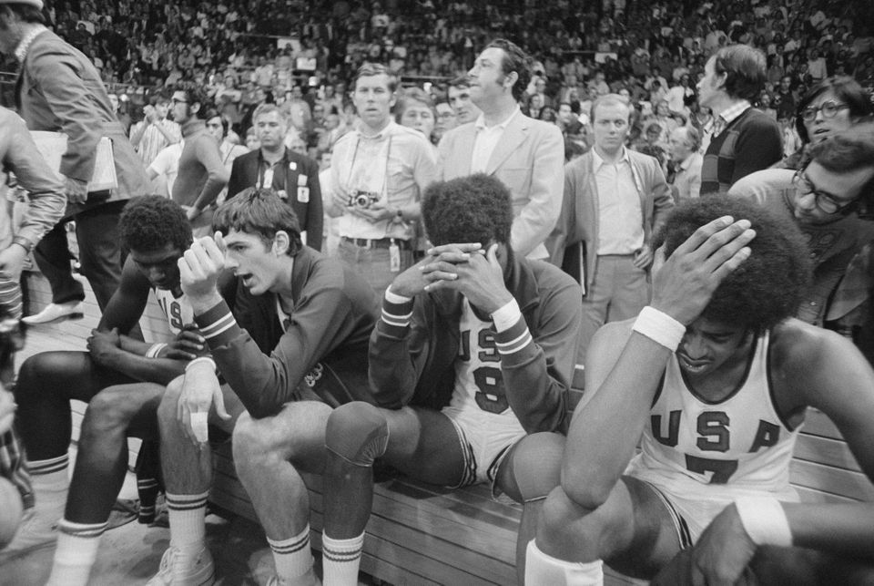 (Original Caption) Dejected. Munich, West Germany: Dejected members of American basketball team sit on...