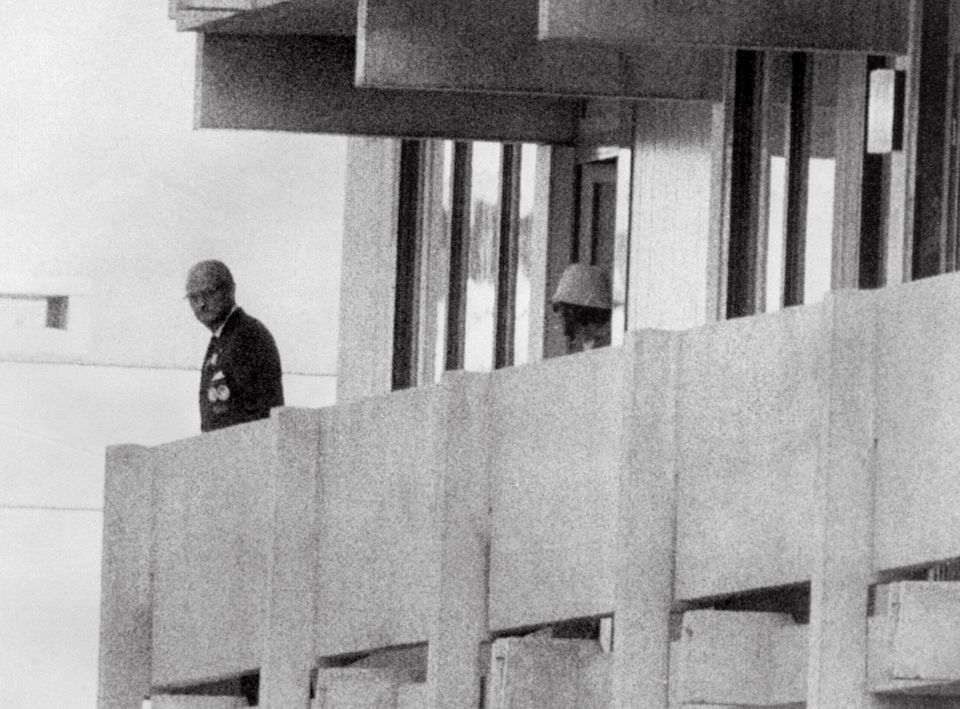 FILES - Picture taken on September 5, 1972 shows a Palestinian guerilla member (C) appearing on the balcony...