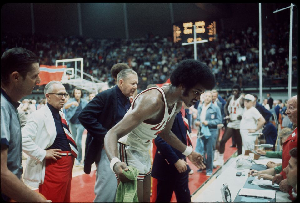 10 SEPT 1972: The US basketball team tries to question the decision of the officials giving the gold...