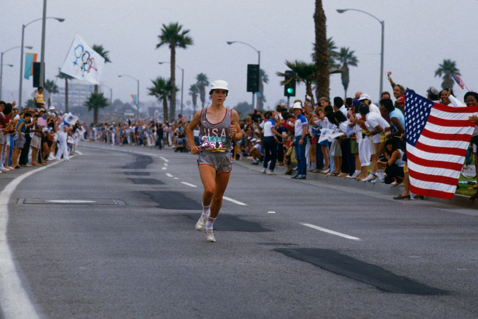 LOS ANGELES - 1984: Olympic gold medalist Joan Benoit runs the last leg of a marathon during the Summer...