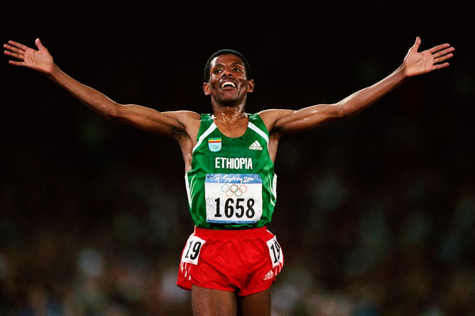 Haile Gebrselassie from Ethiopia celebrates after winning the men's 10,000-meters at the 2000 Olympics....