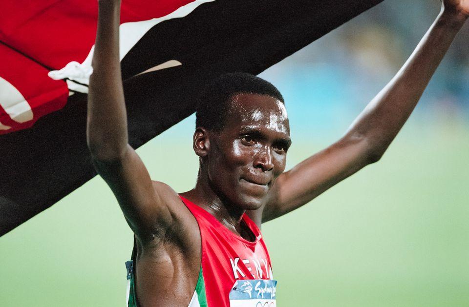 SYDNEY - SEPTEMBER 25: Paul Tergat of Kenya waves the Kenyan flag following his silver medal run in the...