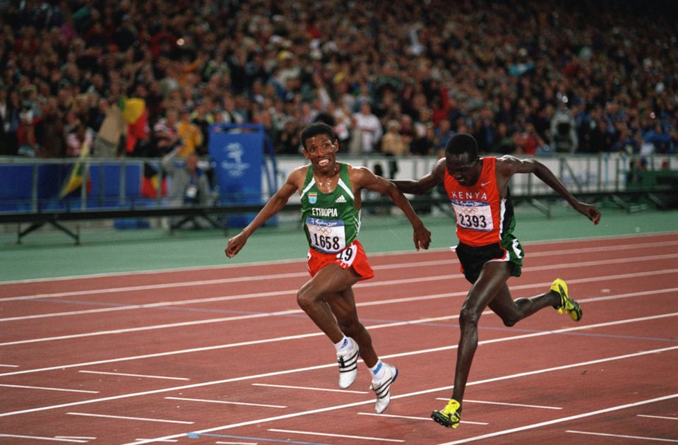 Haile Gebrselassie from Ethiopia and Paul Tergat from Kenya at the finish line of the men's 10,000-meters...