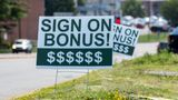 """DANVILLE, PENNSYLVANIA, UNITED STATES - 2021/07/27: A sign reading """"sign on bonus"""" is seen at a Perkin's Restaurant which is hiring workers. (Photo by Paul Weaver/SOPA Images/LightRocket via Getty Images)"""