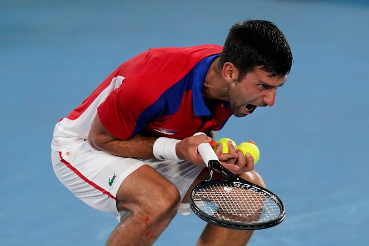 Novak Djokovic, of Serbia, reacts during a semifinal men's tennis match against Alexander Zverev, of Germany, at the 2020 Sum