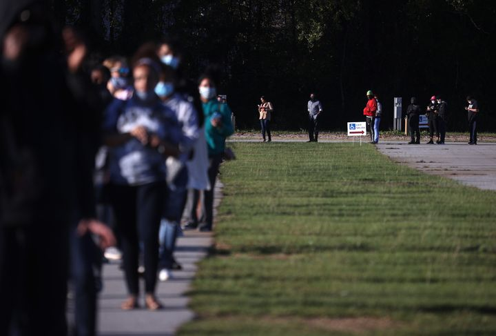 People line up to vote at the Gwinnett County Fairgrounds on Oct. 30, 2020, in Lawrenceville, Georgia.