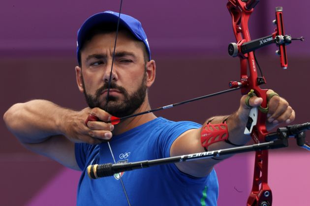 TOKYO, JAPAN - JULY 31: Mauro Nespoli of Team Italy competes in the archery Men's Individual 1/8 Eliminations...
