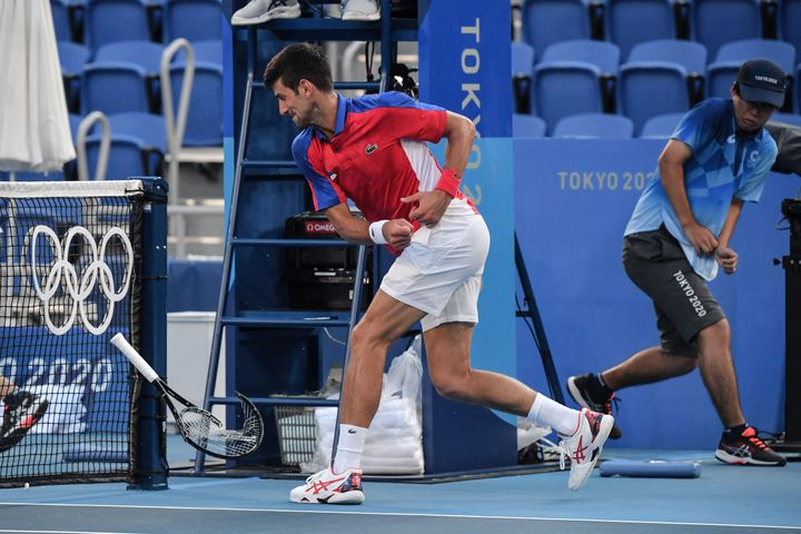 Serbia's Novak Djokovic smashes his racket during his Tokyo Games men's singles tennis match for the bronze medal against Spa
