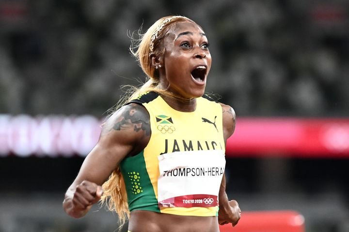 Jamaica's Elaine Thompson-Herah celebrates after her second straight Olympic 100-meter victory.