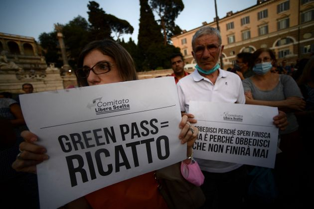 Protestors take part in a demonstration against the introduction of a mandatory 'green pass', in Piazza...