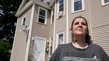 Roxanne Schaefer, of West Warwick, R.I., stands for a photograph outside of her apartment building, in West Warwick, Tuesday, July 27, 2021.