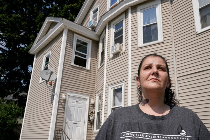 Roxanne Schaefer, of West Warwick, R.I., stands for a photograph outside of her apartment building, in West Warwick, Tuesday,