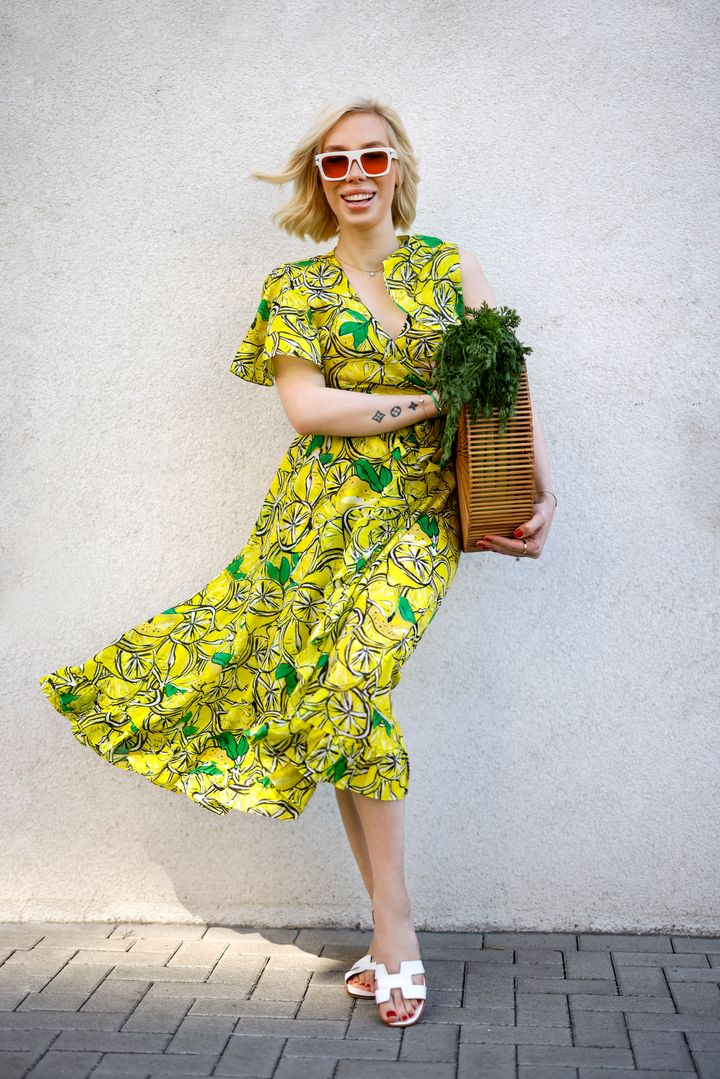 Hairstylist Svenja Simmons wearing a yellow lemon-print top and matching skirt from Diane von Furstenberg during a street style shoot in Dusseldorf, Germany, on June 4, 2021.