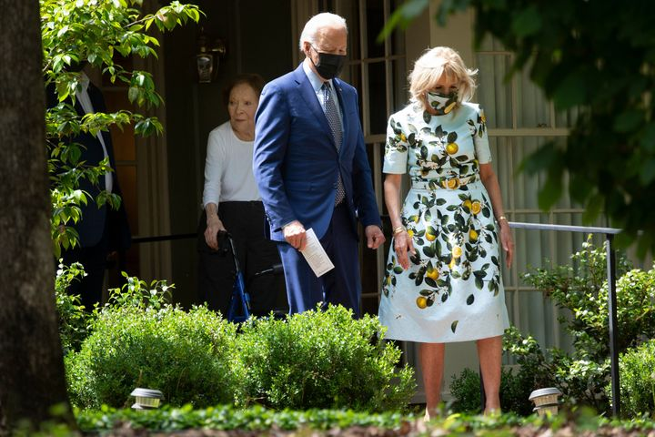 Joe and Jill Biden exit the home of former U.S. President Jimmy Carter on April 29, 2021, in Plains, Georgia.